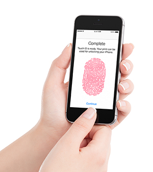 Person holding phone while setting up touch ID
